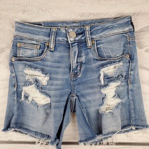 American Eagle Midi Medium Wash Distressed Shorts
